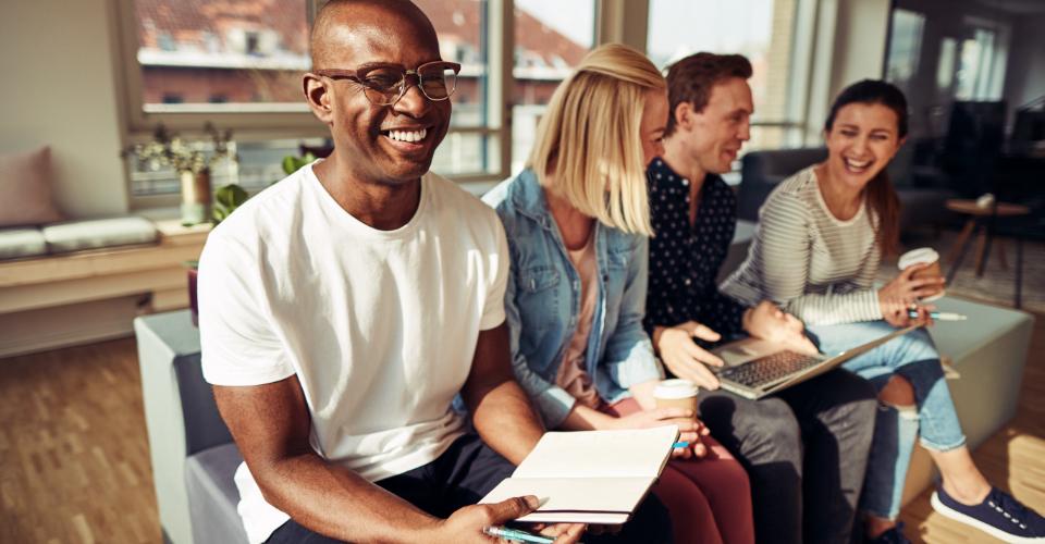 Digital marketing team sitting and smiling