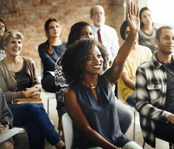 A black women raising her hand