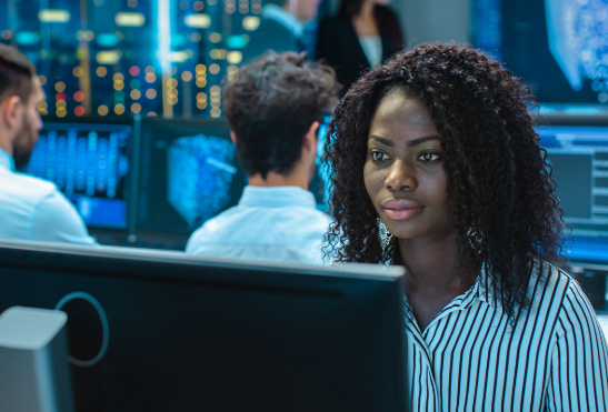 A black woman on a labptop